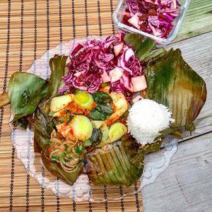 Maleisische vis in bananenblad